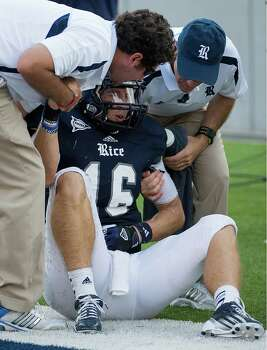 Rice quarterback Taylor McHargue is helped up after being injured on a 47-yard run to set up a field goal forcing overtime during the fourth quarter of a college football game against Marshall at Rice Stadium, Saturday, Sept. 22, 2012, in Houston. Photo: Smiley N. Pool, Houston Chronicle / © 2012  Houston Chronicle