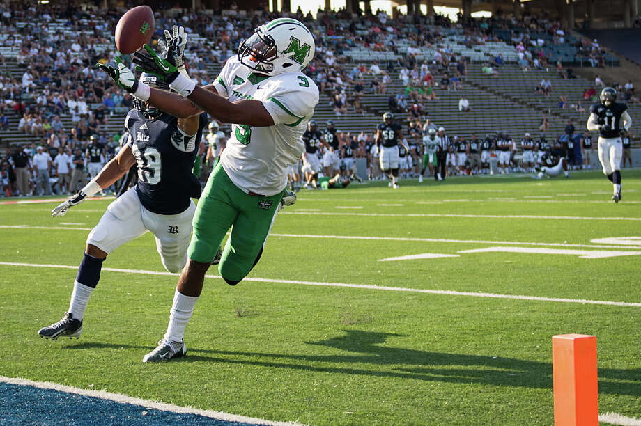 Rice cornerback Bryce Callahan (29) breaks up a pass intended for Marshall wide receiver Aaron Dobson (3) during the fourth quarter of a college football game at Rice Stadium, Saturday, Sept. 22, 2012, in Houston. Photo: Smiley N. Pool, Houston Chronicle / © 2012  Houston Chronicle