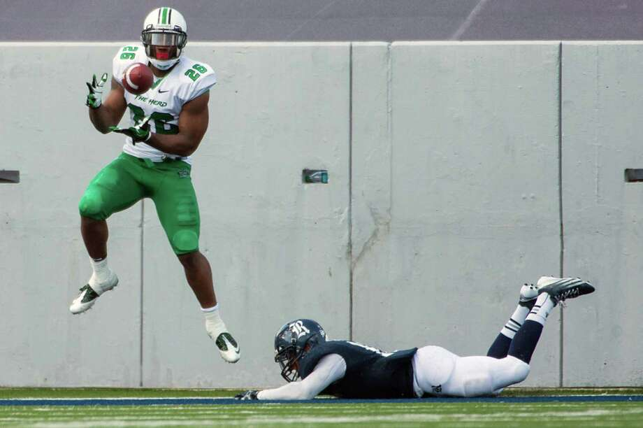 Marshall tight end Gator Hoskins (26) catches a 1-yard touchdown pass during the third quarter of a college football game against Rice at Rice Stadium, Saturday, Sept. 22, 2012, in Houston. Photo: Smiley N. Pool, Houston Chronicle / © 2012  Houston Chronicle