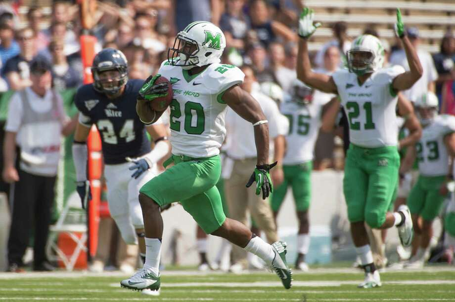 Marshall running back Steward Butler (20) breaks  free of the Rice defense on a 57-yard touchdown run during the first quarter of a college football game at Rice Stadium, Saturday, Sept. 22, 2012, in Houston. Photo: Smiley N. Pool, Houston Chronicle / © 2012  Houston Chronicle