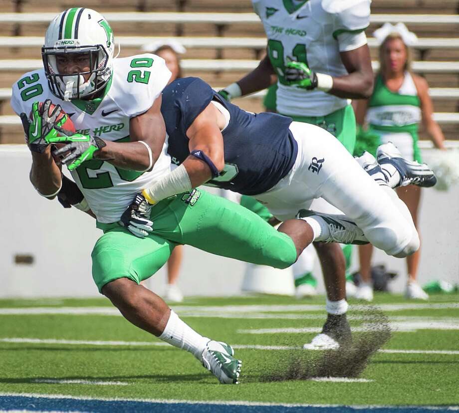 Marshall running back Steward Butler (20) gets into the end zone past Rice cornerback Phillip Gaines (15) on a 57-yard touchdown run during the first quarter of a college football game at Rice Stadium, Saturday, Sept. 22, 2012, in Houston. Photo: Smiley N. Pool, Houston Chronicle / © 2012  Houston Chronicle