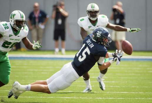 Rice wide receiver Jordan Taylor (15) can't make a catch as Marshall wide receiver DeAndre Reaves (32) defends during the first quarter of a college football game at Rice Stadium, Saturday, Sept. 22, 2012, in Houston. Photo: Smiley N. Pool, Houston Chronicle / © 2012  Houston Chronicle