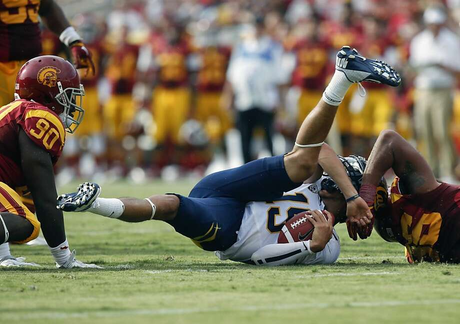 Cal quarterback Zach Maynard goes down - one of seven sacks - as Cal's offensive line was outplayed by USC's defense. Photo: Jae C. Hong, Associated Press