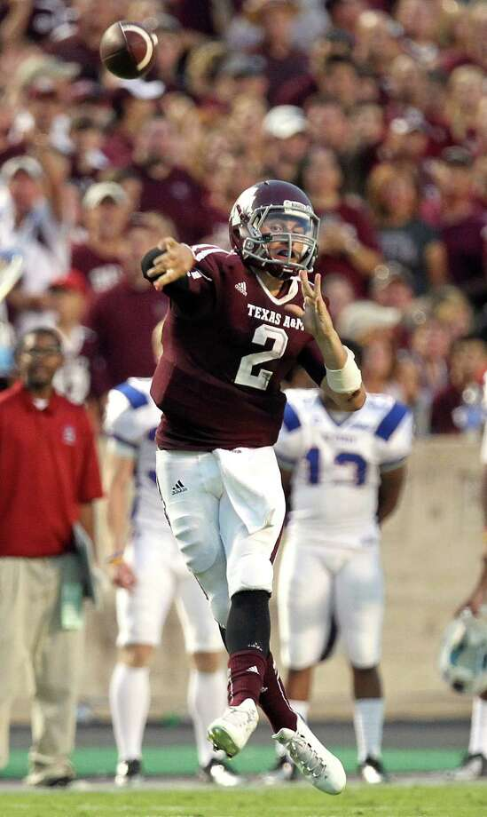 A&M 70, S.C. State 14  Sept. 22, 2012  Manziel lit up the Bulldogs for  174 passing yards and three touchdown passes, while adding 78 rushing yards and  two touchdowns on the ground — all in the first half at Kyle Field. The Aggies  hit the 70-point barrier for the first time since a 73-10 victory against Baylor  in 2003 — despite Manziel wearing a visor by halftime. Photo: Nick De La Torre, Houston Chronicle / © 2012 Houston Chronicle