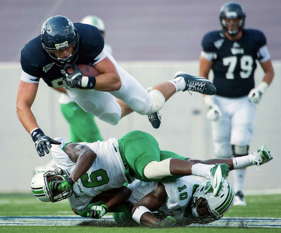 Rice wide receiver Vance McDonald (88) is upended by Marshall safety Dominick LeGrande (6) and safety Okechukwu Okoroha (10) during the third quarter of a college football game at Rice Stadium, Saturday, Sept. 22, 2012, in Houston. Photo: Smiley N. Pool, Houston Chronicle / © 2012  Houston Chronicle
