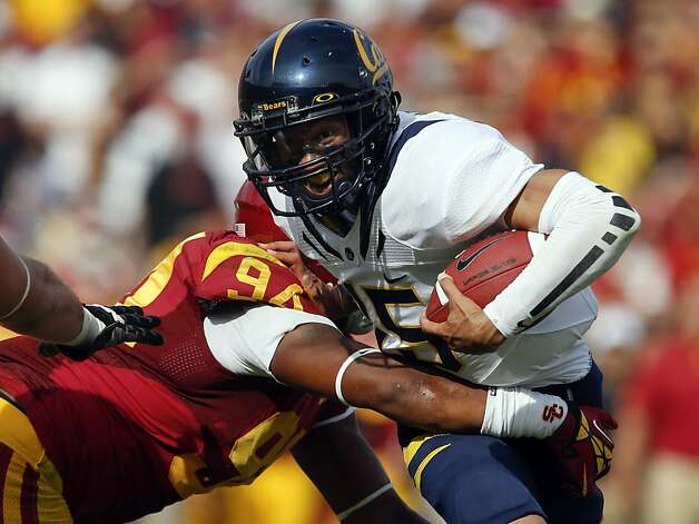 Cal quarterback Zach Maynard, under pressure all game long, is sacked by USC's Leonard Williams in the first half. Photo: Jae C. Hong, Associated Press