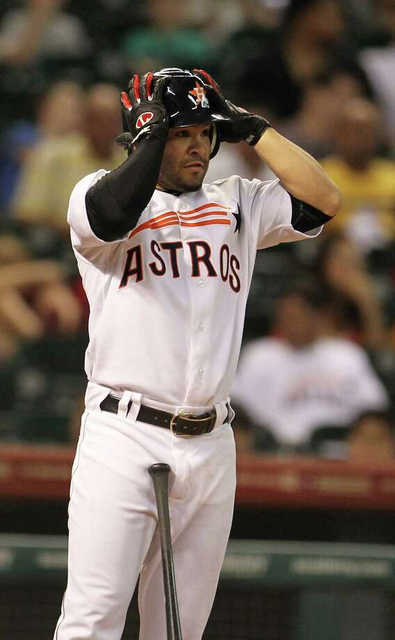 Houston Astros second baseman Jose Altuve (27) adjusts his batting helmet during his at bat during the third inning of an MLB baseball game at Minute Maid Park on Saturday, Sept. 22, 2012, in Houston. Photo: Karen Warren, Houston Chronicle / © 2012  Houston Chronicle