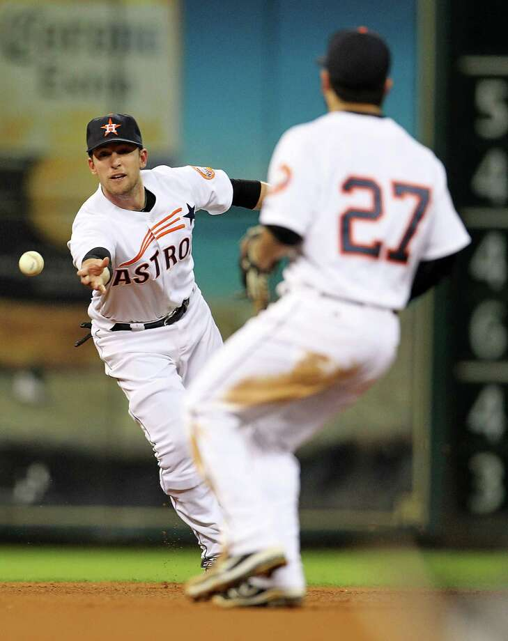 Houston Astros shortstop Jed Lowrie (4) passes the force out ball hit by Pittsburgh Pirates catcher Michael McKenry (55) to Houston Astros second baseman Jose Altuve (27) during the fourth inning of an MLB baseball game at Minute Maid Park on Saturday, Sept. 22, 2012, in Houston. Photo: Karen Warren, Houston Chronicle / © 2012  Houston Chronicle