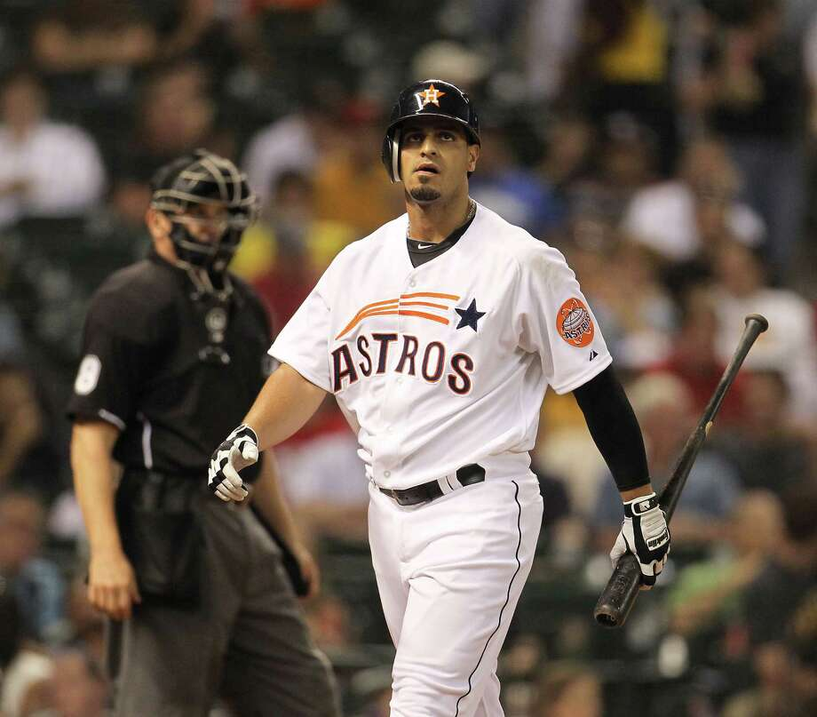 Houston Astros right fielder Fernando Martinez (21) reacts as he strikes out during the fourth inning of an MLB baseball game at Minute Maid Park on Saturday, Sept. 22, 2012, in Houston. Photo: Karen Warren, Houston Chronicle / © 2012  Houston Chronicle