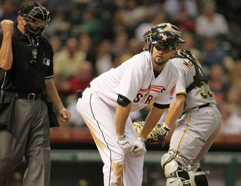 Houston Astros third baseman Scott Moore (46) reacts as he strikes out during the fifth inning of an MLB baseball game at Minute Maid Park on Saturday, Sept. 22, 2012, in Houston. Photo: Karen Warren, Houston Chronicle / © 2012  Houston Chronicle
