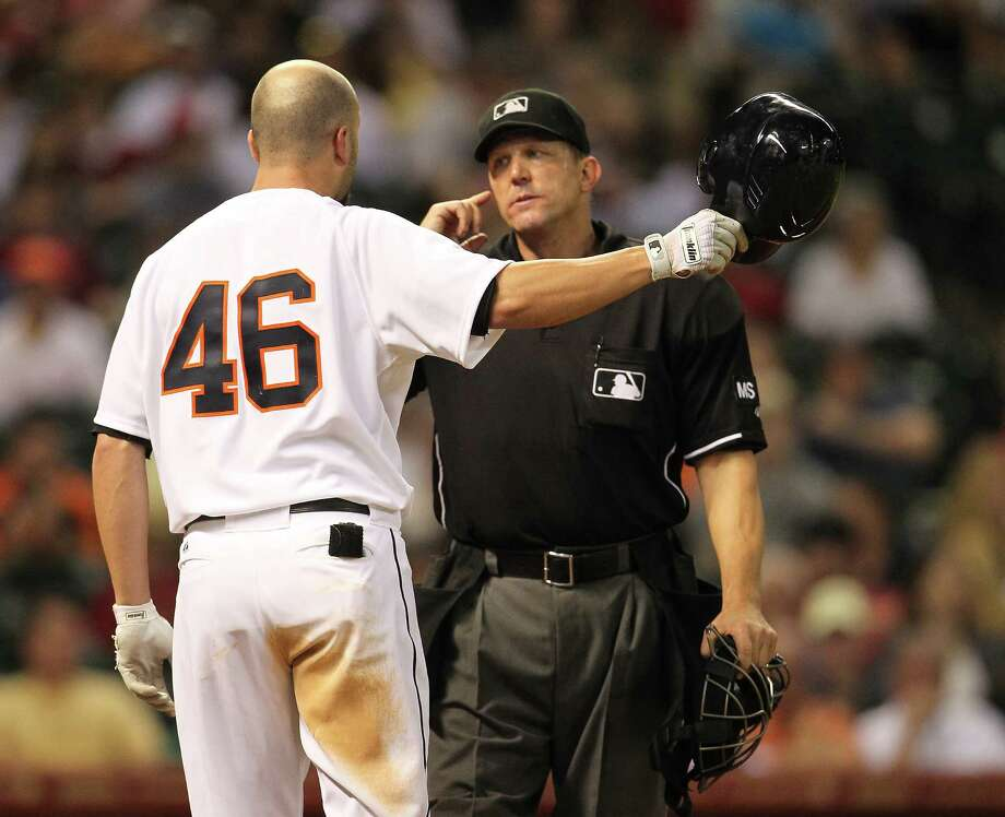 Houston Astros third baseman Scott Moore (46) argues with home plate umpire Jeff Kellogg after he was called out on a strike during the fifth inning of an MLB baseball game at Minute Maid Park on Saturday, Sept. 22, 2012, in Houston. Photo: Karen Warren, Houston Chronicle / © 2012  Houston Chronicle