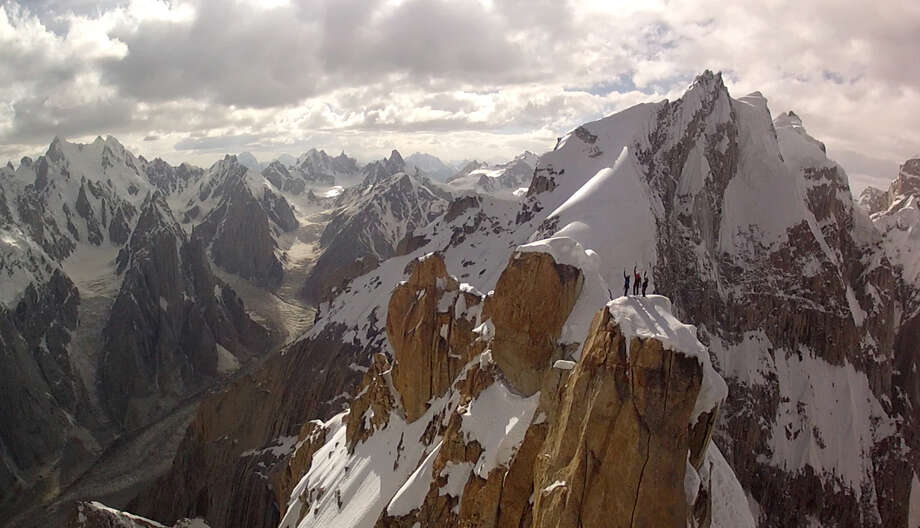 In this July 2012 photo taken from a camera mounted to a remote-controlled helicopter and provided by Remo Massima, Peter Ortner, Corey Rich and David Lama stand atop the Trango Summit in northern Pakistan's Karakoram mountain range. Drones have long been the domain of the U.S. military, which uses them extensively in Pakistan's tribal areas near the Afghanistan border to spy on and target threats to the United States. Recently, however, civilians have increasingly turned to drones to shoot ground-breaking footage or angles of adventure sports. (AP Photo/Remo Massima) Photo: Remo Massima
