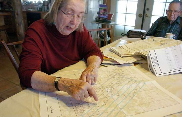 Ellen Pfister points out on a map where the Bull Mountain Mine operates beneath her ranch. Photo: Matthew Brown, Associated Press