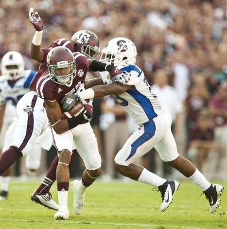 Texas A&M kick returner Dustin Harris (22) avoids a collision with Texas A&M University defensive back Desmond Gardiner (6) and quarter South Carolina State University defensive back Josh McFadden (19) during the first quarter of a NCAA football game, Saturday, Sept. 22, 2012, in College Station.  ( Nick de la Torre / Houston Chronicle )