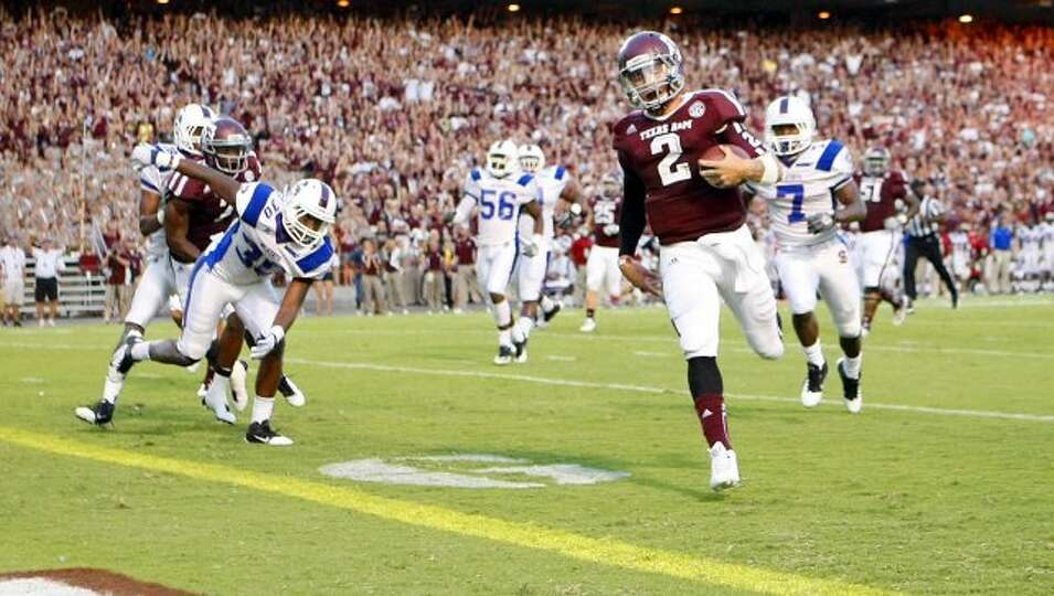 Texas A&M University quarterback Johnny Manziel (2) breaks away from the South Carolina State Univer