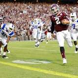 Texas A&M University quarterback Johnny Manziel (2) breaks away from the South Carolina State University defense for a touchdown during the second quarter of a NCAA football game, Saturday, Sept. 22, 2012, in College Station.  ( Nick de la Torre / Houston Chronicle ) (Houston Chronicle)