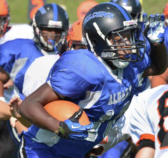 Albany #10 Tysheem Morris carries the ball against Bethlehem in Saturday's game at Bleeker Stadium i