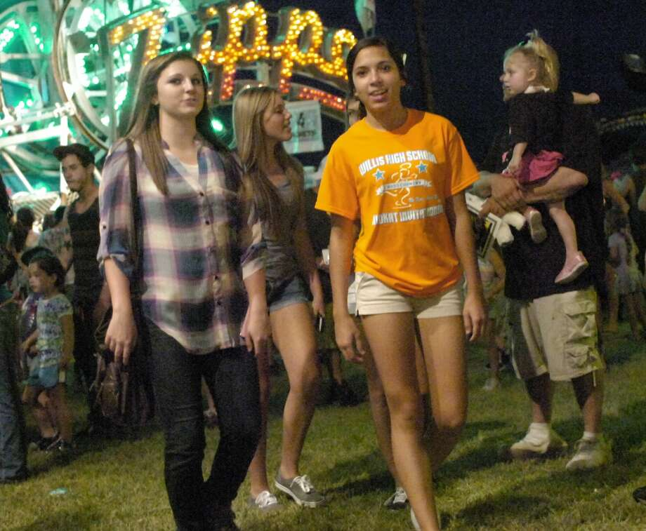 Nederland High School students Megan Haines, 16; Reie Whaley, 15; Keeley Coombs, 15; and Morgan Shaw, 15; enjoyed Saturday night at the Groves Pecan Festival together. The four have grown up attending the yearly event. Photo: Sarah Moore