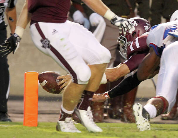 Texas A&M University quarterback Johnny Manziel (2) sneaks the ball into the end zone for a touchdown during the second quarter of a NCAA football game against South Carolina State University, Saturday, Sept. 22, 2012, in College Station. Photo: Nick De La Torre, Houston Chronicle / © 2012 Houston Chronicle