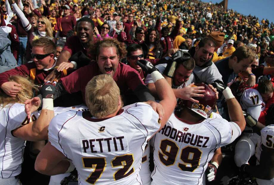 WORST: Little Caesar's Pizza Bowl (Central Michigan vs. Western Kentucky, Dec. 26) -- Over/under on how many times we'll see Bobby Petrino watching the game from the press box.  Offensive lineman Cody Pettit (72) and defensive end Caesar Rodriguez (99) of Central Michigan celebrate with fans on Sept. 22, 2012 in Iowa City, Iowa, after defeating Iowa 32-31. Photo: Matthew Holst, Getty Images / 2012 Getty Images