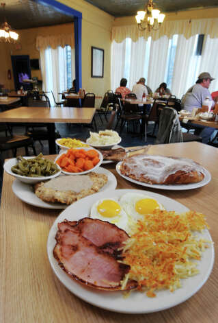 In Southtown, Mr. Tim's Country Kitchen at 620 S. Presa St. is known for down-home cooking that includes the Breakfast Plate, Chicken Fried Steak Plate, the Steak Platter Eggs Plate, and oversized sweet rolls. Photo: ROBIN JERSTAD, E-N Archive / Robert Jerstad