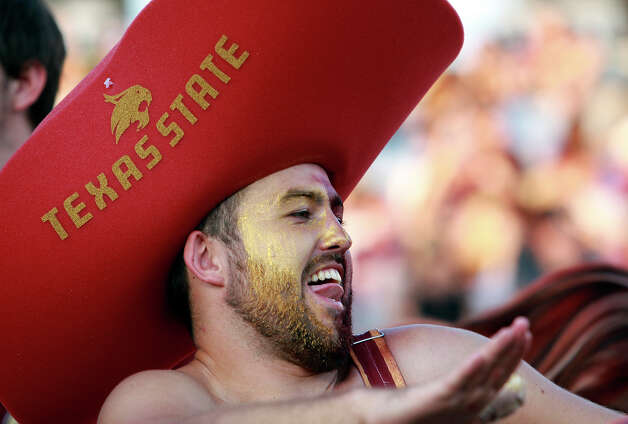 A Bobcat fan celebrates as Texas State hosts Stephen F. Austin at Bobcat Stadium on September 22, 2012. Photo: Tom Reel, Express-News / ©2012 San Antono Express-News