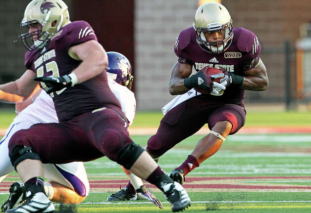 Isaiah Battle cuts away from a tackler as Texas State hosts Stephen F. Austin at Bobcat Stadium on September 22, 2012. Photo: Tom Reel, Express-News / ©2012 San Antono Express-News