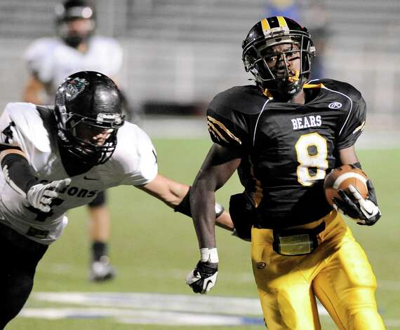 Brennan running back Nathaniel Wells, Jr. runs for a touchdown past Southwest's Cody Johnson during a high school football game, Saturday, Sept. 22, 2012, at Farris Stadium in San Antonio. Photo: Darren Abate, Express-News
