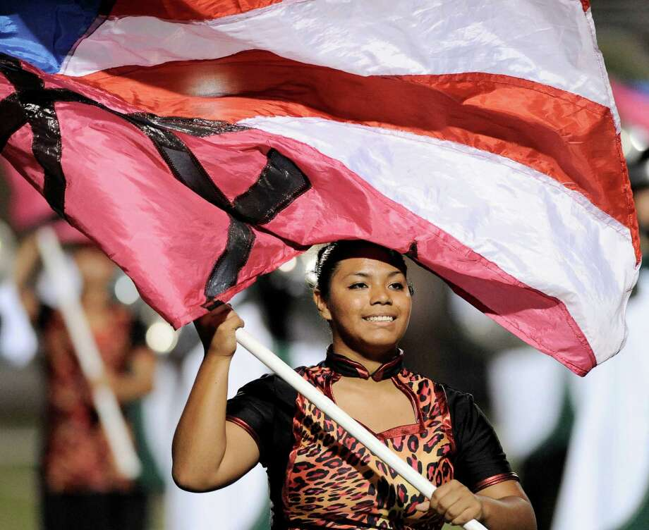 A member of the Southwest color guard performs during halftime of a high school football game against Brennan, Saturday, Sept. 22, 2012, at Farris Stadium in San Antonio. Photo: Darren Abate, Express-News
