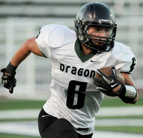 Southwest running back Henry Martinez runs the ball during a high school football game against Brennan, Saturday, Sept. 22, 2012, at Farris Stadium in San Antonio. Photo: Darren Abate, Express-News