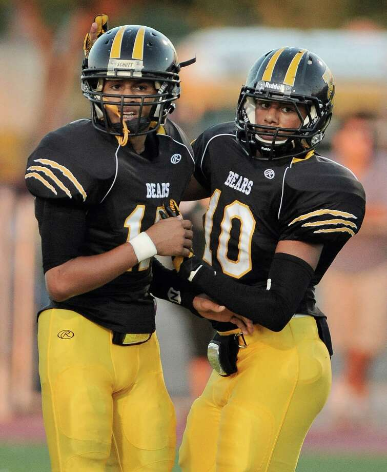 Brennan quarterback Deshawn Key, left, celebrates a touchdown with teammate Torre Davis during a high school football game against Southwest, Saturday, Sept. 22, 2012, at Farris Stadium in San Antonio. Photo: Darren Abate, Express-News