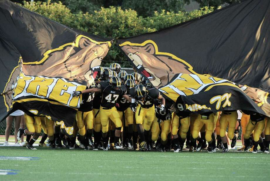 Brennan takes the field before a high school football game against Southwest, Saturday, Sept. 22, 2012, at Farris Stadium in San Antonio. Photo: Darren Abate, Express-News