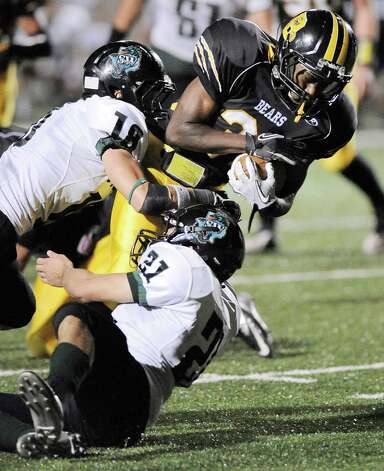 Brennan running back Makai Green, center, is brought down by Southwest's Jaedon Johnson, left, and Josh Huron during a high school football game, Saturday, Sept. 22, 2012, at Farris Stadium in San Antonio. Photo: Darren Abate, Express-News