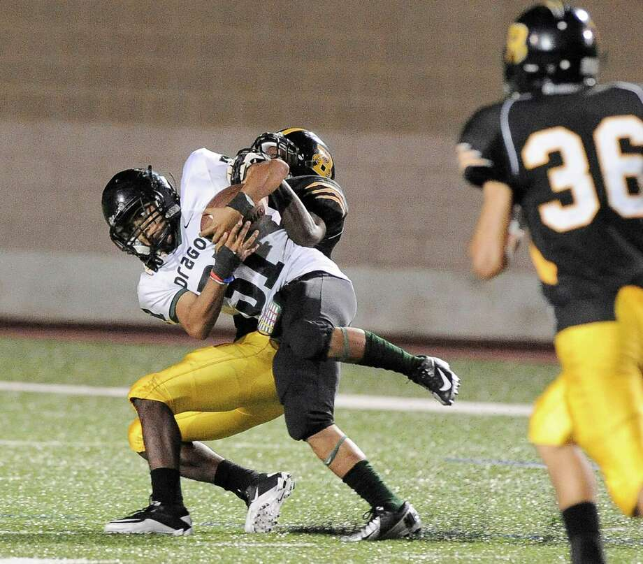 Southwest's Brandon M. Vargas (front) is taken down by Brennan's Llandre Mitchell during a high school football game, Saturday, Sept. 22, 2012, at Farris Stadium in San Antonio. Photo: Darren Abate, Express-News