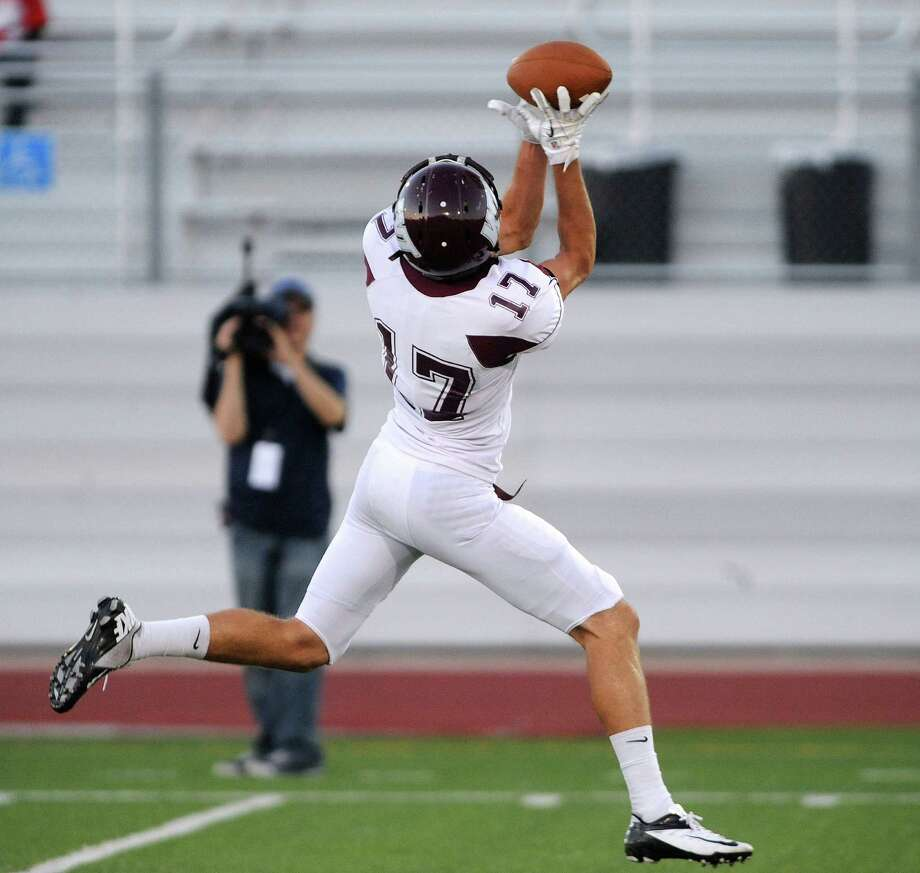 Lance Ratliff of West Texas A&M catches a first-half touchdown pass against Incarnate Word during college football action at Benson Stadium on Saturday, Sept. 22, 2012. Photo: Billy Calzada, Express-News / © San Antonio Express-News