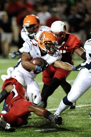 Langston running back is tackled by Lamar linebacker Blake Chavis at Provost Umphrey Stadium on Saturday, September 22, 2012. Photo taken: Randy Edwards/The Enterprise Photo: Randy Edwards