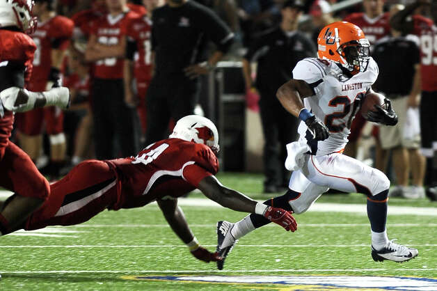 Langston running back William Taylor gets the lions in scoring position before getting tackled at Provost Umphrey Stadium on Saturday, September 22, 2012. Photo taken: Randy Edwards/The Enterprise Photo: Randy Edwards