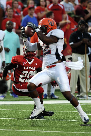 Langston wide receiver Kyron King makes a great completion for a first down against Lamar at Provost Umphrey Stadium on Saturday, September 22, 2012. Photo taken: Randy Edwards/The Enterprise Photo: Randy Edwards