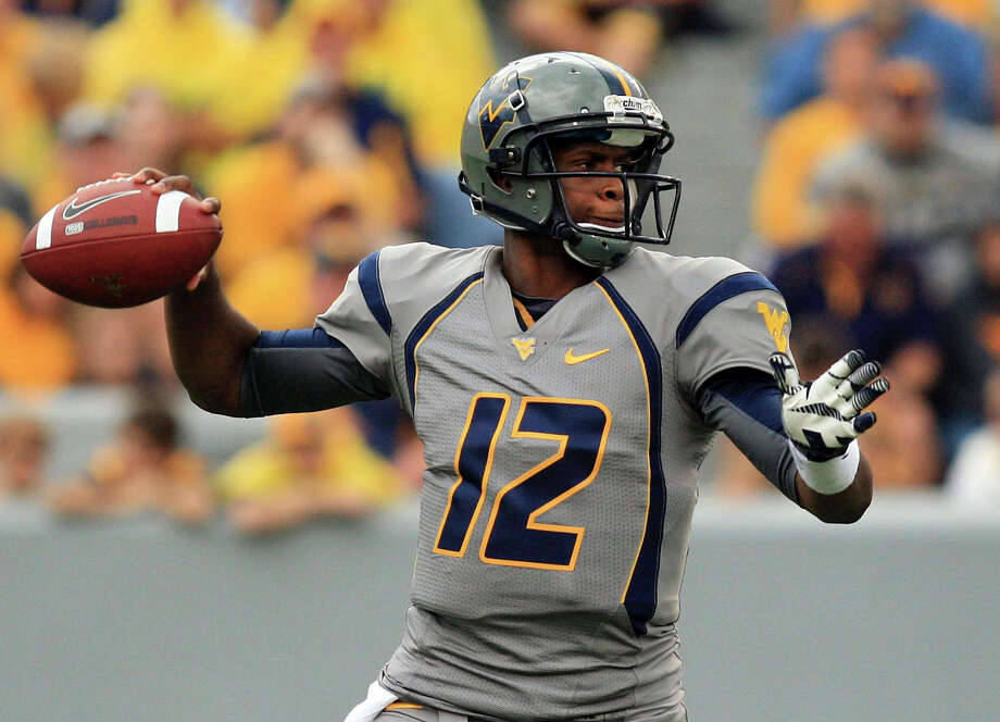 West Virginia quaterback Geno Smith (12) goes to pass during their NCAA college football against Maryland in Morgantown, W.Va. Saturday, Sept. 22, 2012. (AP Photo/Christopher Jackson) Photo: Christopher Jackson