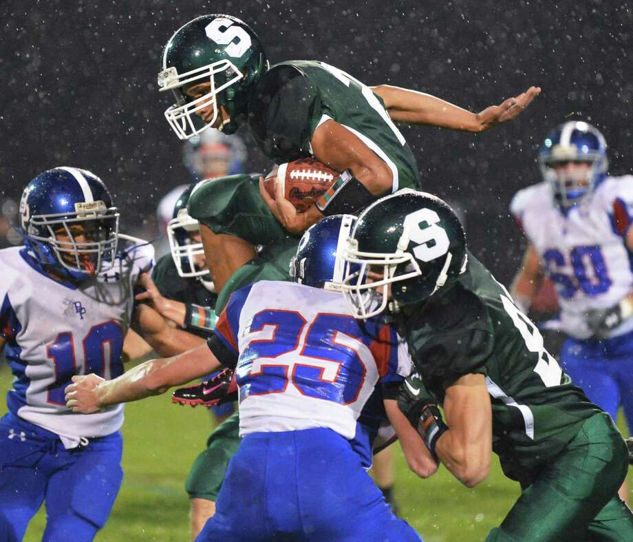 Schalmont's #21 Devon Willis leaps over  Broadalbin-Perth's defense during Saturday night's game in Rotterdam Sept. 22, 2012.  (John Carl D'Annibale / Times Union) Photo: John Carl D'Annibale / 00019330A