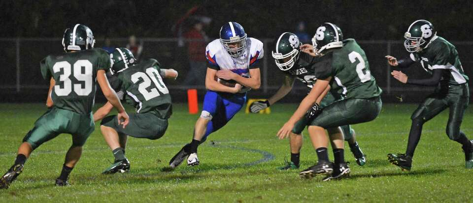 Broadalbin-Perth's #25 Mike Visco is surrounded by Schalmont players during Saturday night's game in