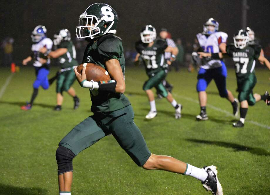 Schalmont's #15 Chas Higgins runs into the end zone to score against Broadalbin-Perth Saturday night in Rotterdam Sept. 22, 2012.  (John Carl D'Annibale / Times Union) Photo: John Carl D'Annibale / 00019330A