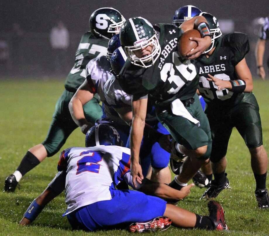 Schalmont's #36 Nick Gallo pushes through Broadalbin-Perth's defense during Saturday night's game in Rotterdam Sept. 22, 2012.  (John Carl D'Annibale / Times Union) Photo: John Carl D'Annibale / 00019330A