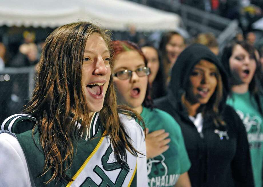 Melissa Narusky, left, sings the Shalmont alma mater with members of the school's concert choir before the start of Saturday night's game against Broadalbin-Perth in Rotterdam Sept. 22, 2012.  (John Carl D'Annibale / Times Union) Photo: John Carl D'Annibale / 00019330A