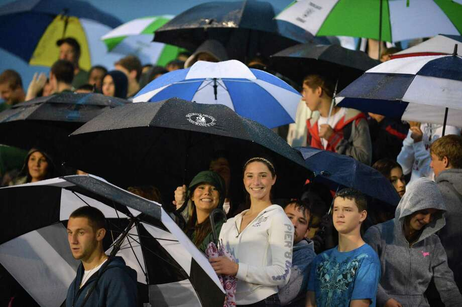 Schalmont fans brave steady rains to watch   Saturday night's game against Broadalbin-Perth's in Rotterdam Sept. 22, 2012.  (John Carl D'Annibale / Times Union) Photo: John Carl D'Annibale / 00019330A