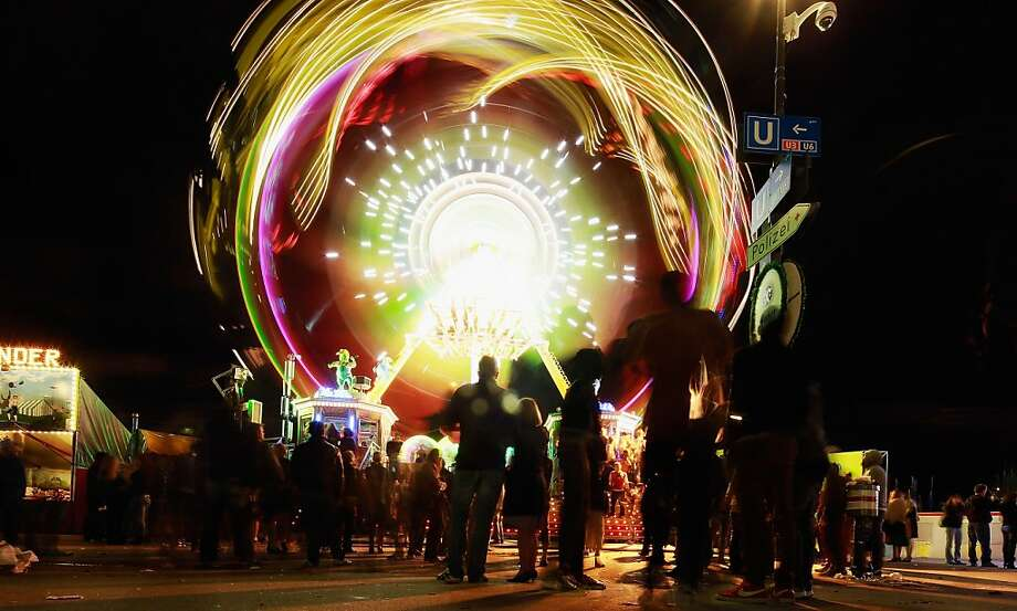 People are attracted by a luminous merry-go-round in the evening of day 1 of Oktoberfest beer festival on September 22, 2012 in Munich, Germany.This year's edition of the world's biggest beer festival Oktoberfest will run until October 7, 2012. Photo: Johannes Simon, Getty Images