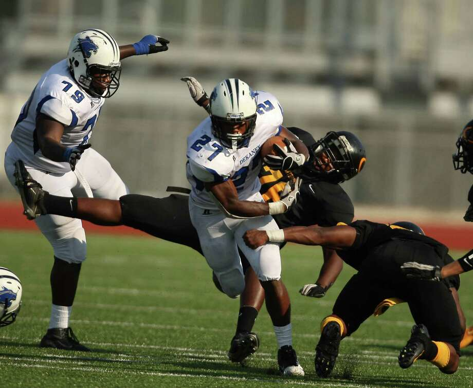 Dekaney running back Demarcus Felton (27) escapes the tackle of a Klein Oak defender during the first half of a high school football game, Saturday, September 22, 2012 at Klein Memorial Stadium in Klein, TX. Photo: Eric Christian Smith, For The Chronicle
