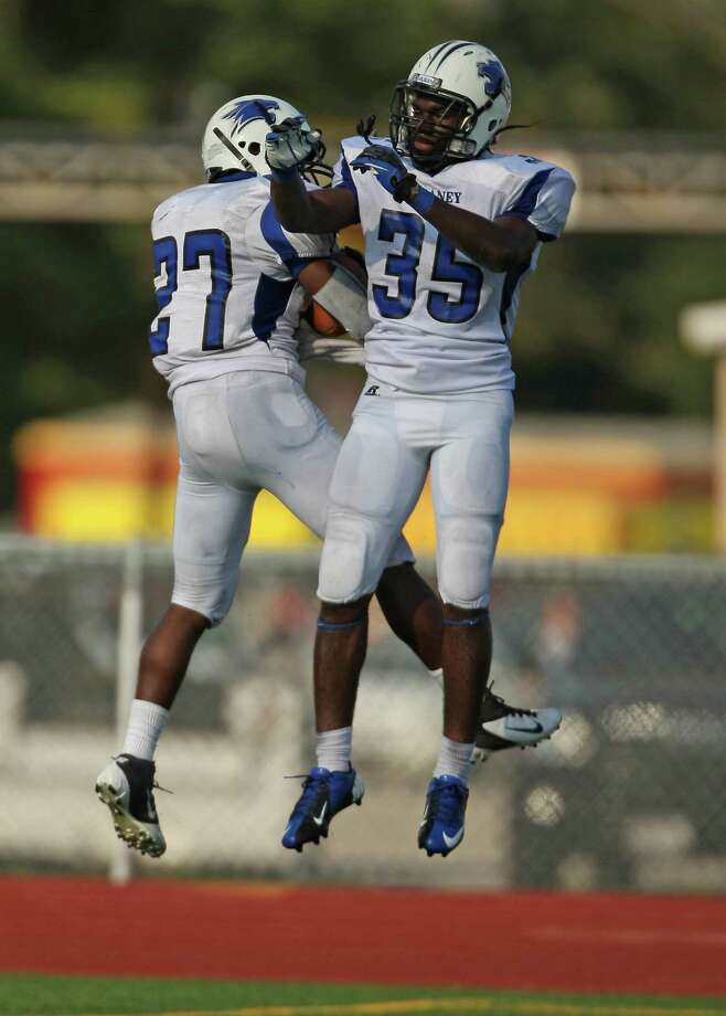 Dekaney's Demarcus Felton (left) celebrates his 63-yard touchdown run with Nat Osei during the first half of a high school football game against Klein Oak, Saturday, September 22, 2012 at Klein Memorial Stadium in Klein, TX. Photo: Eric Christian Smith, For The Chronicle