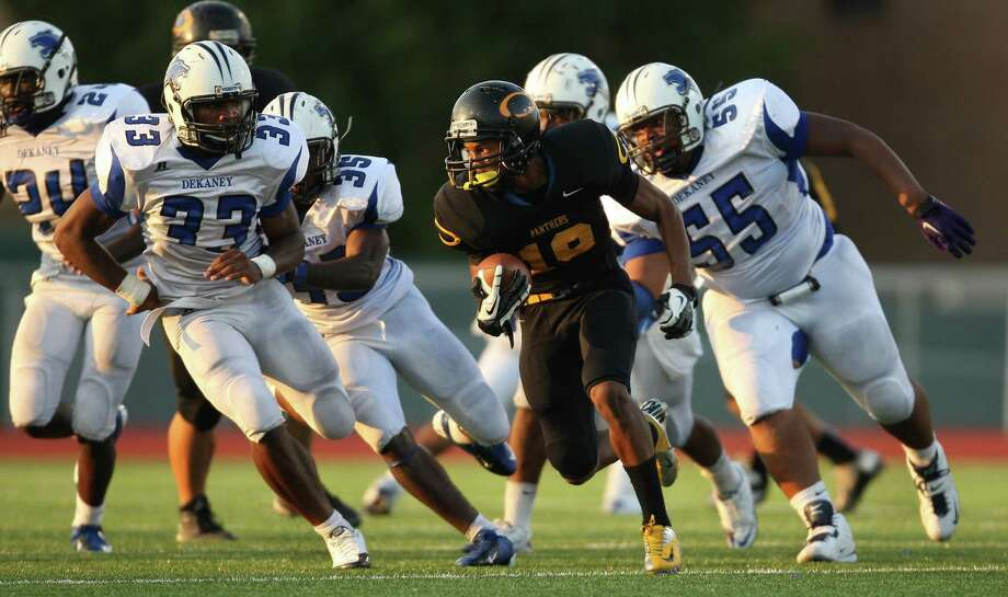 Klein Oak's Eugene Estes (19) tries to escape a wall of Dekaney defenders during the second half of a high school football game, Saturday, September 22, 2012 at Klein Memorial Stadium in Klein, TX. Photo: Eric Christian Smith, For The Chronicle