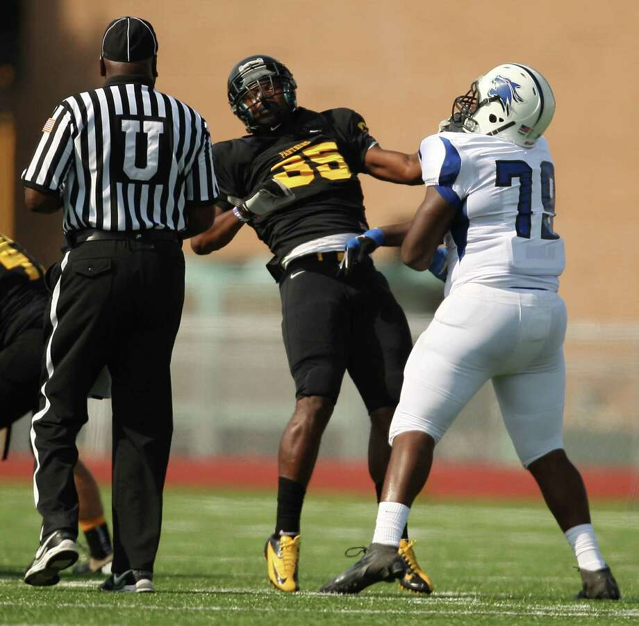 Dekaney's Jared Marshall (79) shoves Klein Oak's Javon Shelley during the first half of a high school football game, Saturday, September 22, 2012 at Klein Memorial Stadium in Klein, TX. Photo: Eric Christian Smith, For The Chronicle